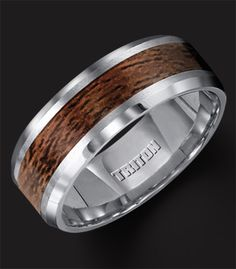 His wedding band. Tungsten carbide with wood inlay made by Triton. Love it!!