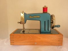 vintage toy sewing machine, made in germany c. 1946, metallic blue. $36.00, via Etsy.