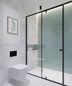 Beautiful bathroom with minimalistic decor and a glass wall to the shower cabin with a black steel frame and gorgeous green tiles on the wall. Bad Inspiration, Bathroom Inspiration, Bathroom Interior Design, Modern Interior Design, Interior Decorating, Bathroom Designs, Beautiful Bathrooms, Modern Bathroom, Bathroom Glass Wall