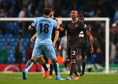 Frank Lampard of Manchester City shakes hands with Ashley Cole of AS Roma at the end of the UEFA Champions League Group E match between Manchester City FC and AS Roma on September 30, 2014 in Manchester, United Kingdom.