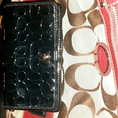 Coach embossed  liquid gloss Demi clutch #F49540 Coach black embossed liquid gloss Demi clutch  $138 Beautiful clutch/wallet.  (No strap) I used as a wallet and put phone in it occasionally Outside back has Zippered pocket  Snap closure with button Silver hardware, patent hangtag. I'D window, 6 card slots, 3 large long pockets Used handful of times, Mint condition Selling at this price due to missing strap Coach  Bags Wallets