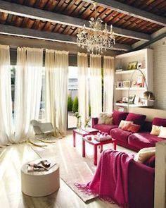pink & cream living room w/ huge windows and chandelier