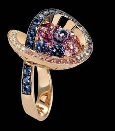 De GRISOGONO | Yellow gold ring set with white diamonds and blue sapphires and pink diamonds