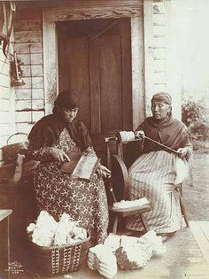 Tulalip women carding & spinning wool on porch, Tulalip Indian Reservation, Washington, 1898