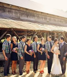 Love the look - navy bridesmaid dresses, plaid groomsmen shirts | Photo by Ken Kienow Photography