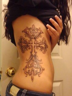 Cross ribcage tat... Beautiful...