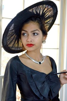 Hattie Carnegie Vintage 1950s Hat ~ Wide Brim New Look Sheer Black Hat This was bought at Montaldos.  ✂ FABRIC: This fabulous design is a beautiful portrait hat made of soft horsehair braid and tulle on a sheer synthetic straw base. The swirled sheer effect is one of mystery and romance.  This cartwheel hat has a distinctly New Look feel with its wide brim and positively chic appearance. Incredibly structured and meant to sit atop a side bun, not on the crown of ones head. This is hel...
