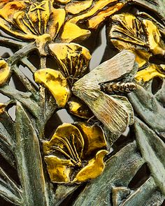 Detail from a Bronze Vessel Featuring the Primrose Moth and Flower. www.thornwoodgallery.com