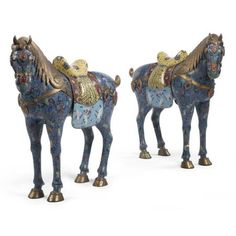 A large pair of Chinese export champlevé enamel horses, early 20th century.