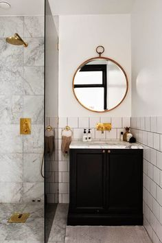 A bathroom should be a fabulous extension of your home. Impress guests with these 10 bathroom trends of 2016 for envy-inducing spring renovations. Dream Bathrooms, Beautiful Bathrooms, Small Bathroom, Master Bathroom, White Bathroom, Shower Bathroom, Brass Bathroom, Bathroom Storage, Round Bathroom Mirror