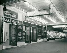 """Odeon Theatre and Times Newsreel Theaterette, Bourke Street, Melbourne. Demolished in 1978 to make way for Centerpoint Mall. Look at all those beautiful """"island"""" shopfronts. A fair swap? Old Pictures, Old Photos, Melbourne Victoria, Old Movies, Beautiful Islands, Victorian Era, Historical Photos, Family History, Rear Projection"""