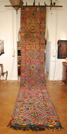Holy beautiful Moroccan carpet runner. A gorgeous riot of color & pattern & little tufts/pom-poms