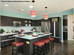 Kitchen islands and black counters are among the hottest trends in kitchen remodels. Adding your own cabinets makes your new kitchen that much better.