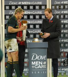South Africa captain Jean de Villiers (l) receieves the trophy off the Prince William, Duke of Cambridge after the International Match between Wales and South Africa at the Millennium Stadium on 09.11.13 in Cardiff, Wales.