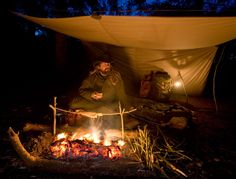 Providing shelter while still open to the night, a tarp is well suited to bushcraft use.  http://www.ravenlore.co.uk/html/shelter.html