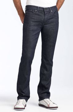 Baggy jeans are out of style. Go for a slimmer (not skinny) pair like this.