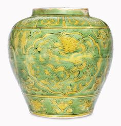 A rare green and yellow-glazed dragon jar, Wanli six-character mark in underglaze blue within a double circle and of the period (1573-1619).