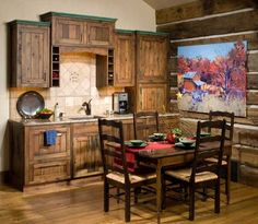Reclaimed wood kitchen. The wood floor is actually reclaimed corral panels. | Stylish Western Home Decorating