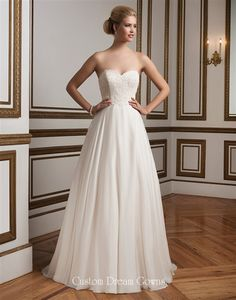 Satin A-Line Gown with Strapless Sweetheart Neckline, Alencon Lace Fitted Bodice with Natural Waistline, Chiffon Over Satin A-Line Skirt, Chapel Train, Scalloped Lace Mid V-Back with Covered Buttons.