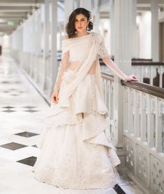 Get yourself dressed up with the latest lehenga designs online. Explore the collection that HappyShappy have. Select your favourite from the wide range of lehenga designs Indian Wedding Gowns, Indian Gowns, White Wedding Dresses, Indian Bridal, Reception Dresses, Indian White Wedding Dress, Indian Wear, Wedding Lehnga, Indian Lehenga
