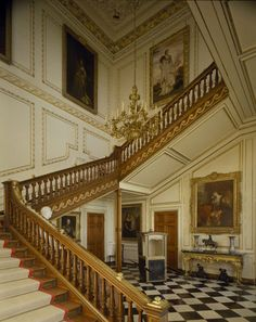 Belton House staircase, with a sedan chair in the entrance foyer!