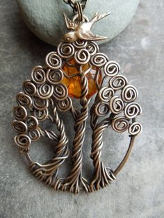 Beautiful! I love making tree of life necklaces but this one takes the cake with 3!
