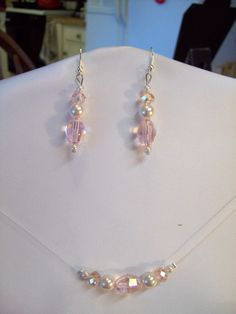 Wedding Bridal Swarovski Crystal Light Pink and Pearl ILLusion Floating Necklace and Earring Set. $15.00, via Etsy.