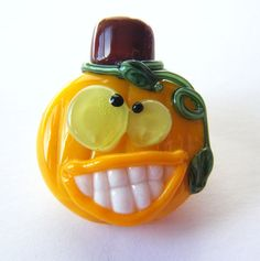 This is hilarious and super fun!!    Grinning Pumpkin Lampwork Bead by keiara SRA FREE by bykeiara