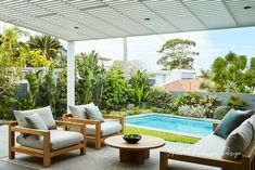 Bare backyard transformed into a contemporary coastal garden Horticulturist and designer Adam Robinson shares the clever landscaping tips he used to create a relaxed outdoor space and coastal garden for the owners of this eastern Sydney home. Backyard Pool Landscaping, Backyard Pool Designs, Small Backyard Pools, Landscaping Tips, Backyard Ideas, Tropical Landscaping, Outdoor Lounge, Outdoor Spaces, Outdoor Living