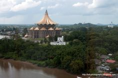 The Sarawak State Assembly building and Fort Margherita and the Sarawak River seen from the 14th floor of the Riverside Majestic Hotel in Kuching, Malaysia in January 2012