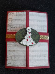 One of my latest Gatefold Shutter Cards, using Yuletide Carol paper, Ruby Cardstock, Gold Shimmer trim, Pink Glitter Gems, Olive ink, and Tree Delights Stamp on the outside and Santa's Greeting inside. All products are available from www.lindajestrimski.ctmh.com.au