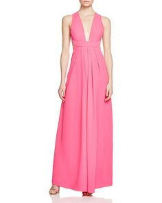 Flash some skin for evening in this plunging Jill Jill Stuart V-neck gown with a low-cut, criss-cross back.