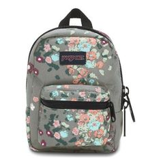 The JanSport Lil' Break Backpack is made of rugged 600D polyester and features a small main compartment and a zippered pocket.