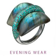 """2012 AGTA Spectrum Award Winner: Evening Wear - 1st Place:  Ion Ionescu  Ionescu Design, Inc.  New York, NY  Palladium and black rhodium """"Pillow for Dreaming"""" ring featuring a 36 ct. carved Labradorite accented with paraiba Tourmalines (1.50 ctw.)."""