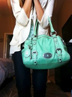 I have to get this bag..a trip to the woodlands mall is in my future!!