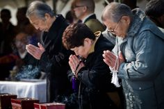 Japan Earthquake: One Year Later - In Focus - The Atlantic People pray as they attend a Buddhist memorial service at a makeshift shrine for the victims from Okawa Elementary School, killed in last years tsunami, on March 03, 2012 in Ishinomaki, Japan. (Daniel Berehulak/Getty Images)