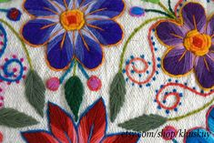 Vibrant, colorful flowers pop beautifully from the cream background of our hand embroidered cushion covers. Our pilllows are first woven on a traditional loom with sheep wool and later adorned with beautiful embroidered flowers made of alpaca wool. A playful crochet trim gives this cushions