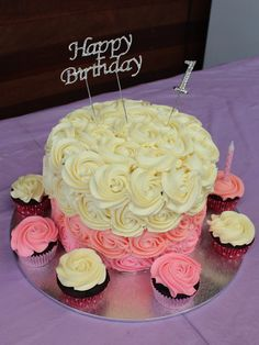 Pink ombré rosette cake. 1st birthday cake with rosette cupcakes