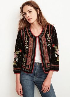 Styled like a vintage event jacket, this cropped beauty from Velvet is the statement piece of the season. Black velvet with allover floral embroidery patterns,