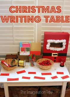 Christmas Post Office Writing Table - I love this idea! Real materials to play with - cards, envelopes, markers, tape, alphabet stamps and ink, glue, pens, ribbon, bows