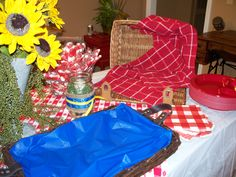View of picnic basket that held BBQ buns & basket with blue liner ready for tray of baked beans