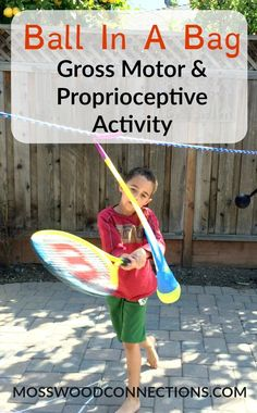 Ball in a Bag a fun, simple gross motor activity to work on visual tracking, ball skills, and proprioception motor skills.