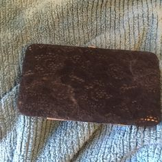 A cute black velvet wallet A cute black velvet like wallet! I bought three years ago from wet seal I have never worn but once still like brand new Wet Seal Bags Wallets