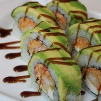 American Dream Sushi Roll: Avocado, rice, seaweed, cream cheese, shrimp tempura, eel sauce, and spicy crab.