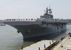 Sailors and Marines man the rails as USS Bataan (LHD 5) prepares to moor in New York for Fleet Week 2016 (FWNY).