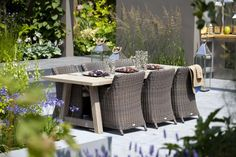 Outdoor stylish living with chairs and table in a garden patio