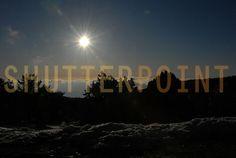Evening sun on mountain snow photo - ShutterPoint Photography