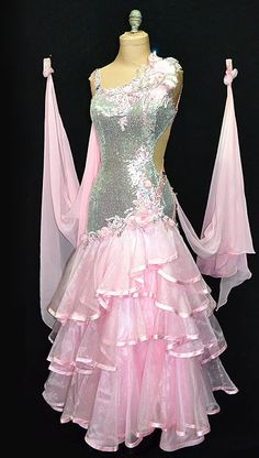 Disco themed pink standard dress with sequence and rhinestones from Designs to Shine by Maria McGill. Visit http://ballroomguide.com/comp/attire/lady.html for more info about competition attire.