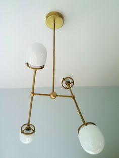 The Emery chandelier was inspired by the kinetic sculpture of Lin Emery, a New Orleans based artist, whose work can be found at NOMAs sculpture