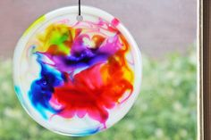 Art for Kids: Cosmic Suncatchers:  white glue, liquid food color, toothpick.  Takes 3 days to dry.